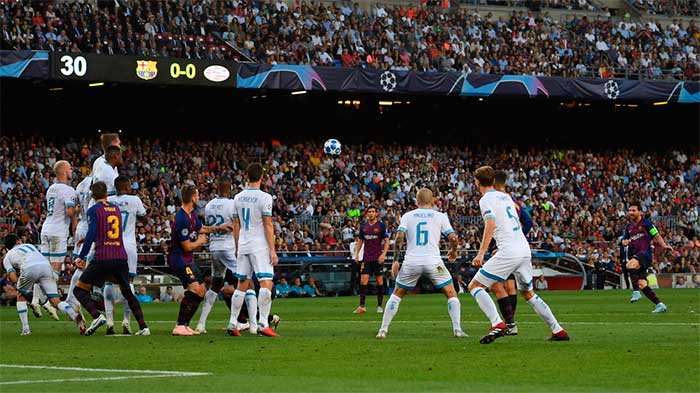 Lionel Messi of Barcelona scores his team`s first goal during the Group B match of the UEFA Champions League between FC Barcelona and PSV at Camp Nou on September 18, 2018 in Barcelona, Spain