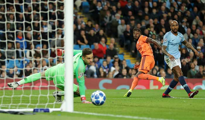 Maxwell Cornet of Lyon scores his teams first goal past Ederson of Manchester City during the Group F match of the UEFA Champions League between Manchester City and Olympique Lyonnais at Etihad Stadium on September 19, 2018 in Manchester, United Kingdom